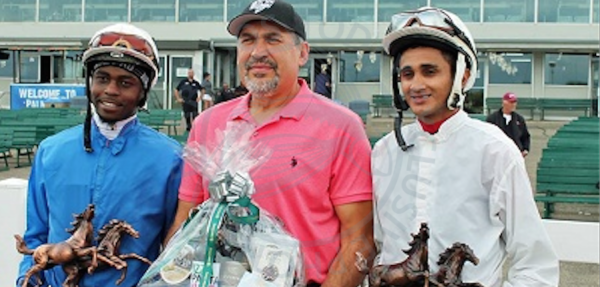 Antonio Whitehall (left) and Prayven Badrie (right) pose with leading trainer Jerry Gourneau following the conclusion of the meet. (Photo courtesy Assiniboia Downs)
