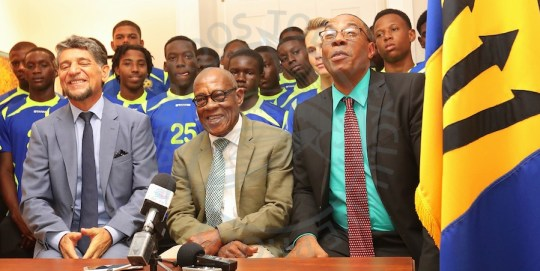 (From left) Argentina's ambassador Gustavo Pandiani, BFA president Randy Harris and Minister of Creative Economy, Culture and Sports John King with some of Barbados' best young footballers. (Picture by Morissa Lindsay).