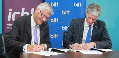 ICBL Chief Executive Geoff Scott (left) and head of Bitt Senator Rawdon Adams signing a memorandum of understanding yesterday.