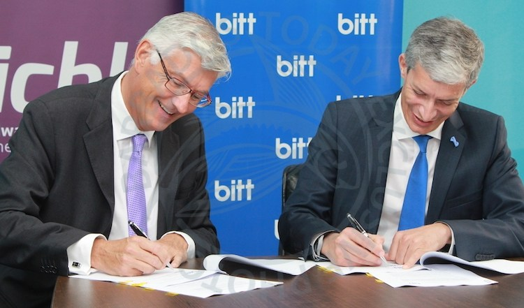 ICBL Chief Executive Geoff Scott (left) and head of Bitt Senator Rawdon Adams signing a memorandum of understanding yesterday.