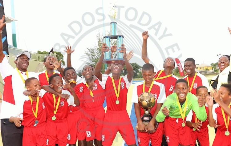 Coleridge and Parry celebrate their first BSSFL Under-14 title with principal Sonja Brathwaite (right) and coach Don R. Small (left). (Picture by Morissa Lindsay)