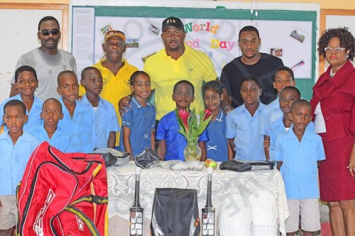 Dwayne Smith (third, left rear) at the presentation ceremony with pupils and staff of Eden Lodge Primary.