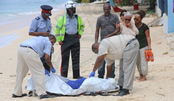 Family members of the late Victor Dawson were distraught as they watched employees of Two Sons Funeral Home remove the body of their loved one from Fitts VIllage Beach.