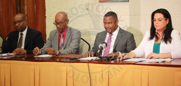 From left, BWA General Manager Keithroy Halliday, Permanent Secretary in the Ministry of Energy and Water Resources Jehu Wiltshire Minister of Energy and Water Resources Wilfred Abrahams and Chairman of the BWA board Leodeane Worrell at today's press conference.