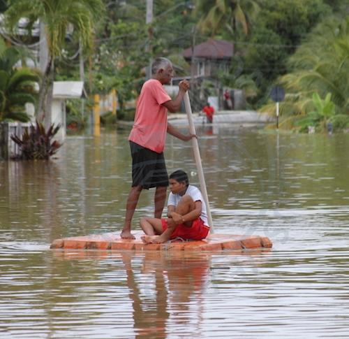 Rowing to safety in the waterlogged village of Mayaro. (Photo: Rishi Ragoonath)