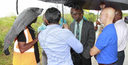 Minister in the Ministry of Transport Works and Maintenance Peter Philips (center), IDB Representative Juan Carlos De La Hoz Vinas second from right) and other Ministry officials being briefed on the project.