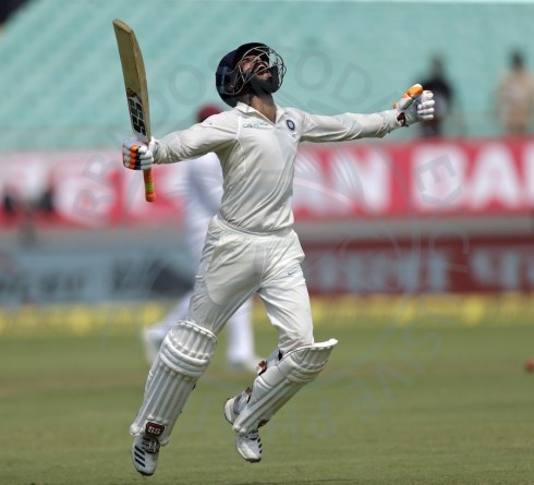 Ravindra Jadeja savours reaching his landmark against the West Indies.