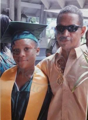 Khadejah Gill (left) and her father Edmund Gill, on the day she graduated from Trinity Academy.