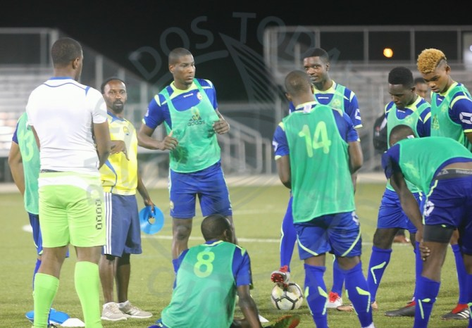 BFA technical director Ahmed Mohammed (third left, wearing yellow) standing beside former national captain Mario Harte (fourth left) during last night's training session. (Pictures by Morissa Lindsay)