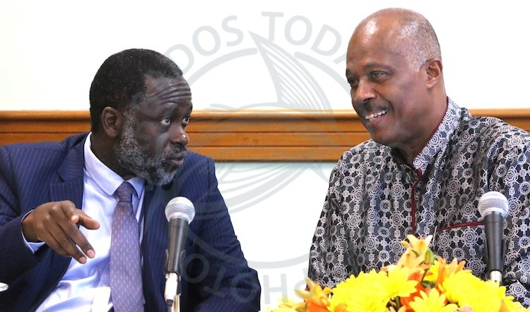 Professor Adekeye Adebajo (left) chats with Vice Chancellor of the UWI Sir Hilary Beckles during today's media launch.