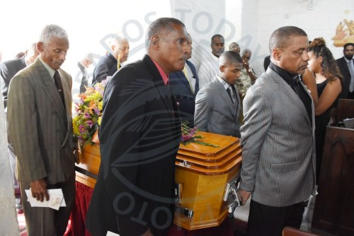 Andrea Gollop-Greenidge's relatives carrying her casket into the church.