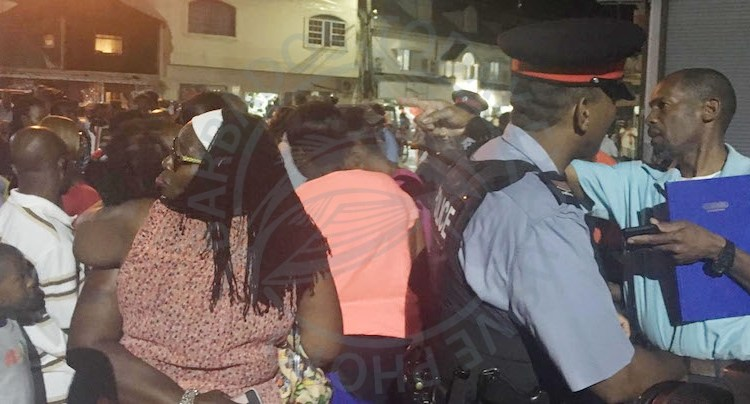 A large crowd gathered at the scene where Oscar Hamblin was shot dead in The City.