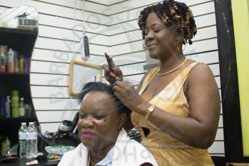 Owner of Pretty Girls Salon Kareen Best styles her client Katherine Best's hair.