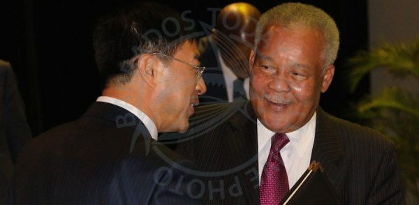 Former Prime Minister Owen Arthur (right) speaking with Chinese Ambassador to Barbados Yan Xiusheng this morning at the UWI.