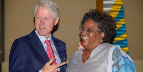 Former US president Bill Clinton and Prime Minister Mia Mottley enjoying a light moment.