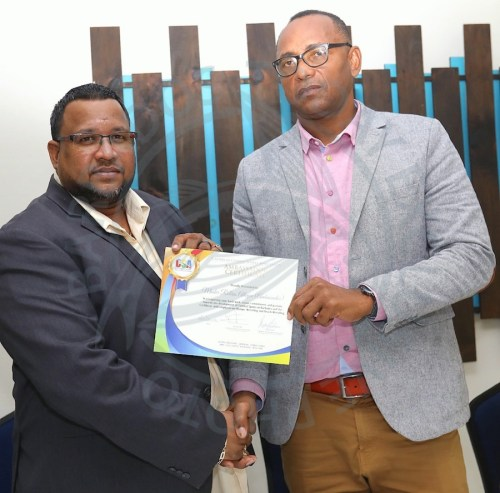 (From left) President of the Caribbean Sambo Association Jason Fraser presented president of Barbados Wrestling Association Rollins Alleyne with a certificate of appreciation. (Picture by Morissa Lindsay)