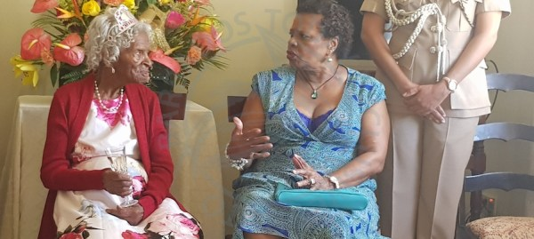 Governor General Dame Sandra Mason and 100-year-old Coral Agard chatting during this morning's visit.