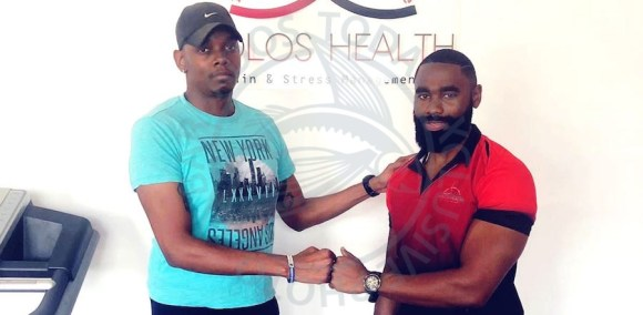 Jeshua Ferdinand (left) with owner of Holos Health, Pain and Stress Management.
