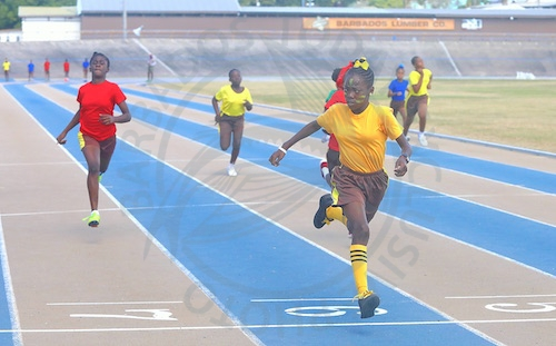 Maliqua Cherubin of Yellow House crosses the line first to capture the Under-13 Girls 100m.