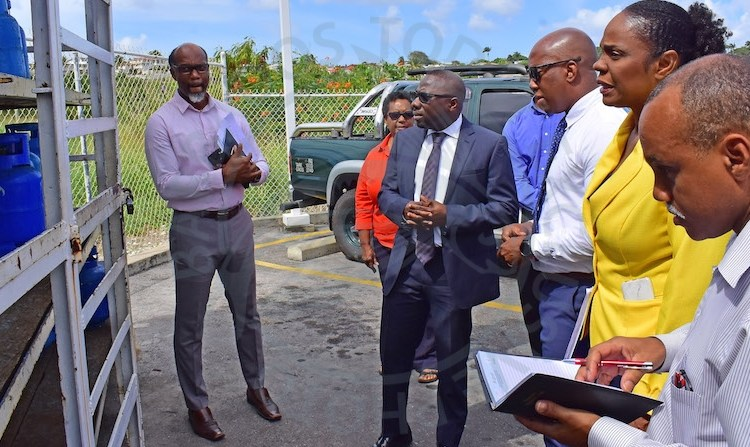 Minister of Small Business, Entrepreneurship and Commerce Dwight Sutherland (in suit) with Sol general manager Ezra Prescod (third right) and other officials yesterday.