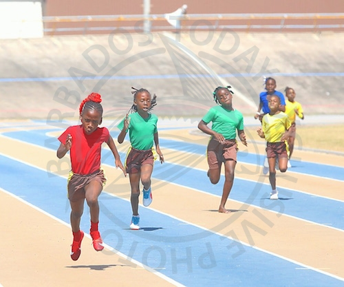 Shonica Small of Red House powering to victory in the Under-11 Girls 200m.
