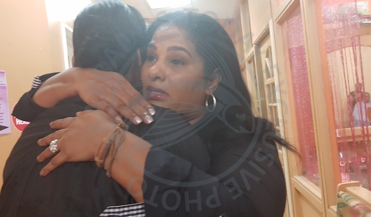 Joy-Ann Haigh (right) embracing Charmaine Ifill, the mother of the Down Syndrome eight-year-old boy who was allegedly abused by a teacher at the Ellerton Primary School Special Education Unit.