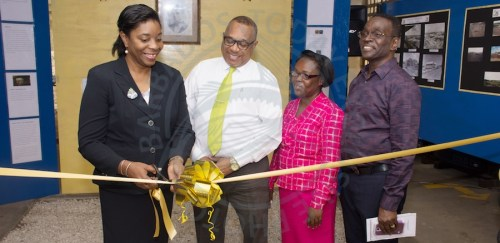 From left, SJPI Library assistant, Annette Clarke officially opening the exhibition with principal Ian Drakes, librarian Julia Ward and chairman of the board of management Shelton Perkins.