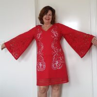 Red cut out lace dress, not a tablecloth after all!