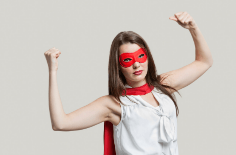Woman striking the superhero pose. Is she Too Stupid to Live?