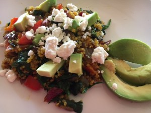 Warm quinoa spinach tomato and feta salad