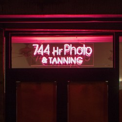 744 Hr Tanning & Photo 2012 Neon sign mounted on Plexiglas 11 x 30 inches, 28 x 76 cm Installation view, 2012, Rawson Projects, Brooklyn NY