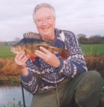 John R with one of a number of 4lb+ perch he's taken from a tiny stream.