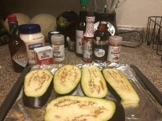 Eggplant's sliced, pictured along with spices for the mayo and marinating sauce for the eggplant itself.