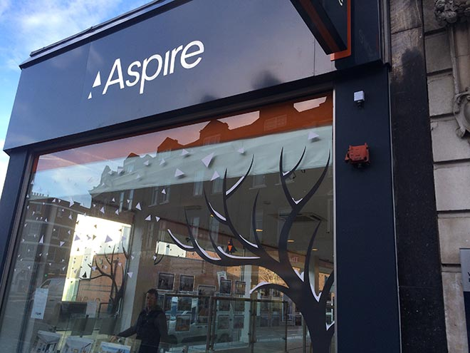 Aspire Estate agents in store front