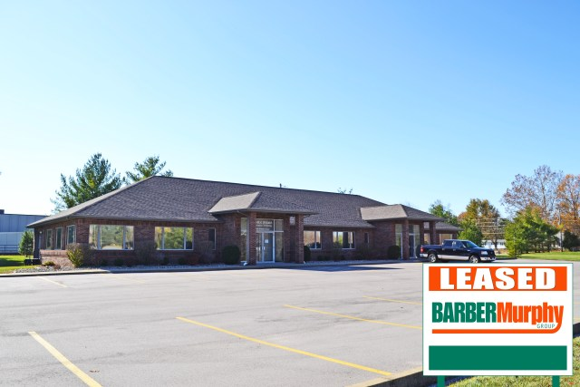 dark brick office building leases space in fairview heights illinois