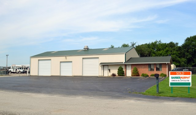 brick office building attached to tan industrial warehouse building in edwardsville illinois
