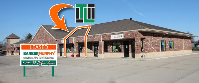 exterior of brick strip mall retail space leased to Tower Loans of Illinois in Maryville illinois