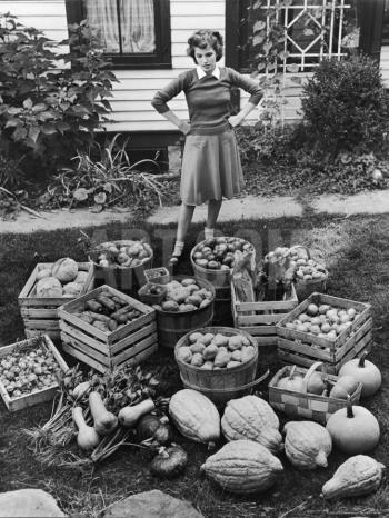 Woman looking at victory garden harvest