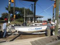 Clean Coast President and Mgr. Jim Eising take out their Skiff after a successful clean-up on Blackbeard Island.