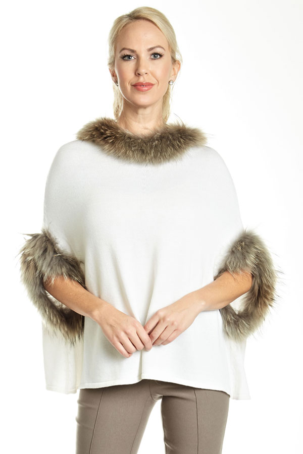 close-up of fur trimmed knit poncho white