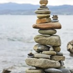 Balanced stack of stones on the seashore