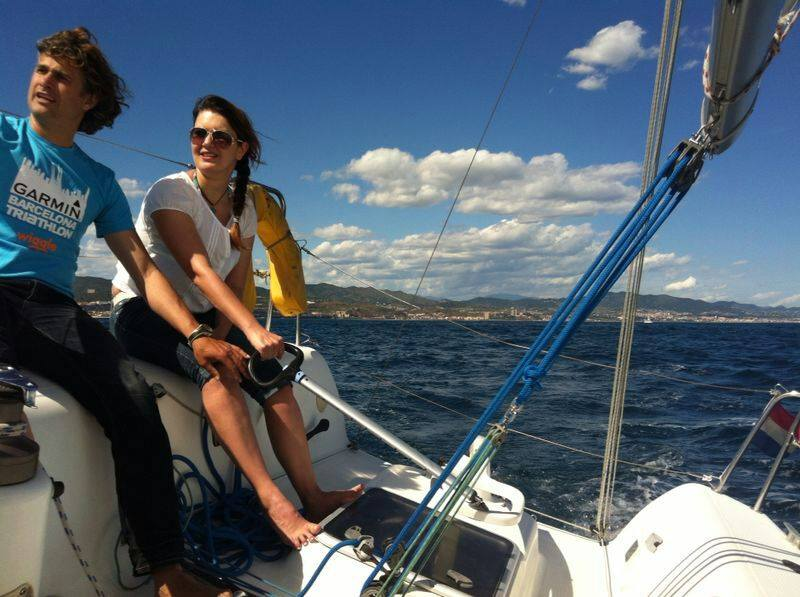 Sailing and teaching how to sail in front of Barcelona coast line