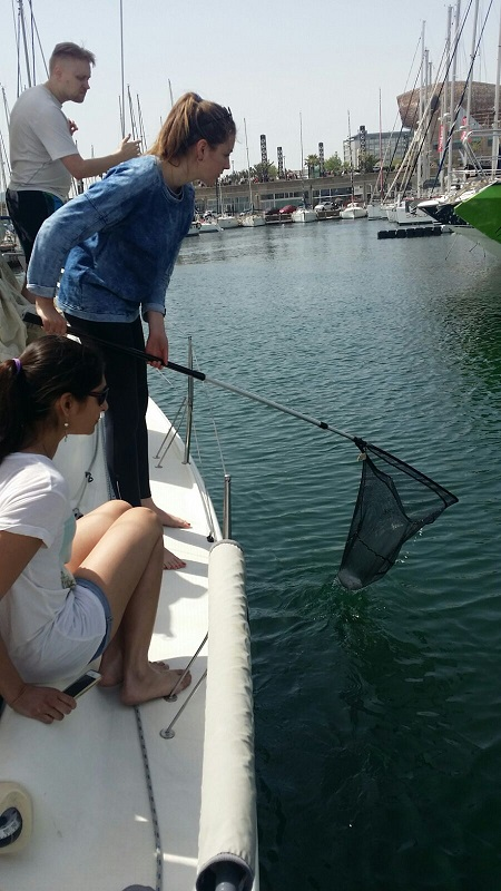 fishing plastic while sailing n Barcelona