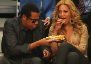 Jay-Z and Beyonce Knowles having something to eat at the 2011 (60th) NBA All-Star Game at Staples Center in downtown Los Angeles, CA.  Pictured: Jay-Z and Beyonce  Ref: SPL250855  200211   Picture by: London Entertainment/ Splash News  Splash News and Pictures Los Angeles:	310-821-2666 New York:	212-619-2666 London:	870-934-2666 photodesk@splashnews.com  (Newscom TagID: spnphotosthree347340.jpg) [Photo via Newscom]