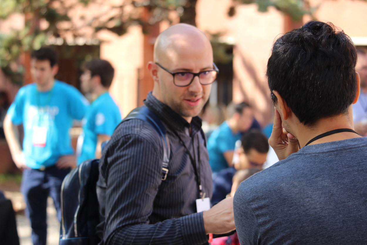 Conversations between entrepreneurs about their startups during networking break at Startup Grind Conference in Barcelona