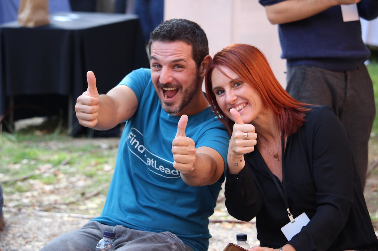 Two attendees pose for the camera at Startup Grind Conference in Barcelona