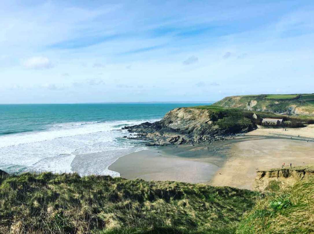 blue sky and calm sea at church cove beach Cornwall