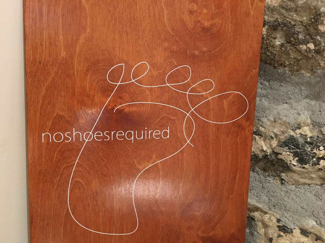 wooden bellyboard in the bathroom
