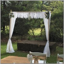 Wedding arbour with peonies & lace garland. Maroochy Botanical Gardens, Sunshine Coast.