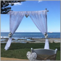 Wedding arbour with lace curtains & lace garland.